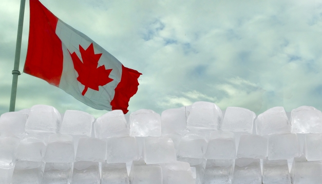 wall of ice flying the Canadian Flag